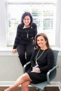 Kyla Sipprell and Holly M. Groce of Clemmons Family Law in their office