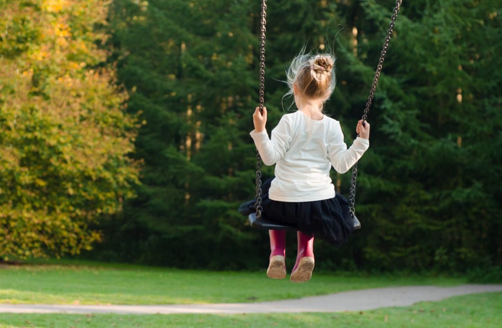 A child swings on a playground. Clemmons Family Law attorneys can help with child support needs. Photo by Skitterphoto from Pexels