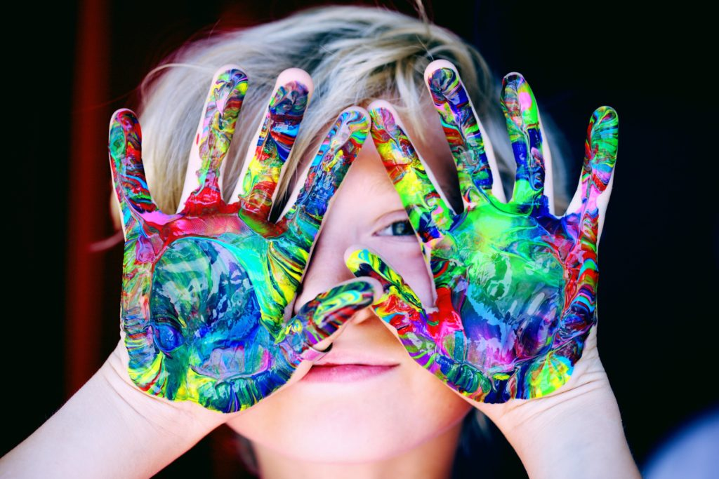 A child with colorful fingerpaints. Clemmons Family Law focuses on child custody issues. Photo by Sharon McCutcheon from Pexels